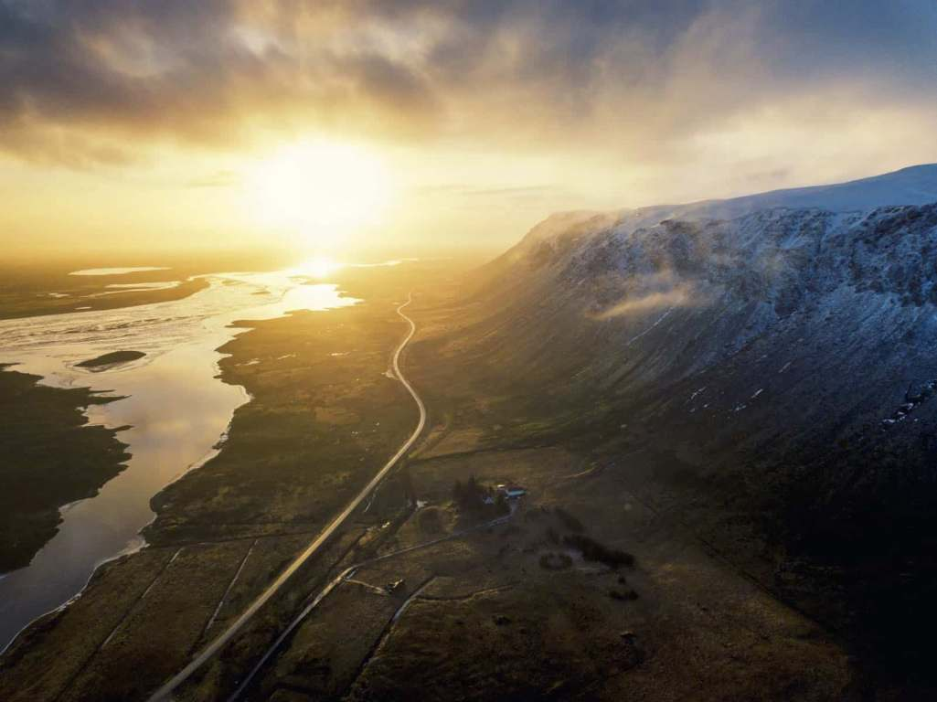 Aerial shot from drone of Golden Circle Route with mountain and beautiful sunrise