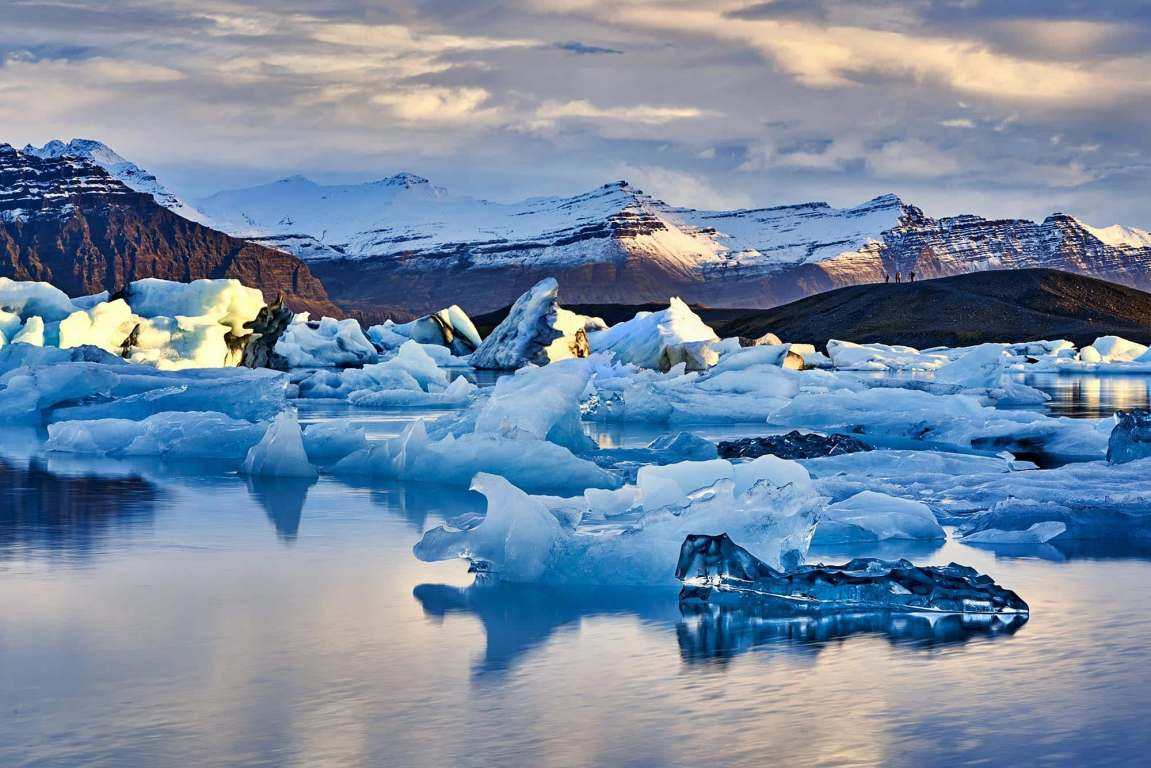 Ice floating in Jökulsárlón Glacier lagoon and mountains in the distance